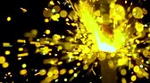 сияющий : Bright yellow sparkler against dark background. Super slow motion shallow focus video, 500 fps