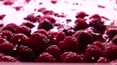 recipe : Red raspberries rolling in shallow water, super slow motion clip