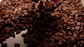 кофе в зернах : Man scooping roasted coffee beans, super slow motion shot