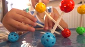 öğretici : Little boy playing with colorful plastic construction set. Molecule models. 4K close up video