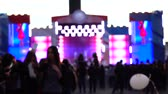 vaidade : Blurred girl making selfie with her phone. Outdoor live show. Slow motion shot