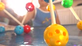 öğretici : Boy playing with colorful plastic construction set. Balls and pins. 4K close up video