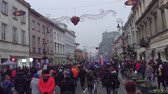 manifestação : WARSAW, POLAND - DECEMBER, 17, 2016. People with Polish and EU flags marching in the street. Vídeos
