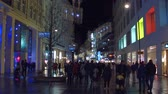 swarovski : VIENNA, AUSTRIA - DECEMBER, 24 Steadicam shot of Christmas decorated pedestrian street in the evening. Popular touristic destination with stores and cafes.