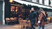 PARIS, FRANCE - DECEMBER, 31, 2016. Steadicam walk along beautiful Parisian brasserie, small restaurant, with awnings. 影像素材