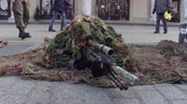 tlumič : KRAKOW, POLAND - JANUARY, 14, 2017 Special force sniper wearing disguise camouflage suit at military show.