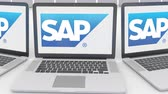 сок : Laptops with SAP SE logo on the screen. Computer technology conceptual editorial Стоковые видеозаписи