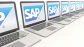 сок : Modern laptops with SAP SE logo. Computer technology conceptual editorial