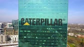 catálogo : Aerial shot of office skyscraper with Caterpillar Inc. logo. Modern office building.