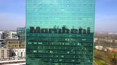 district : Aerial shot of office skyscraper with Marubeni Corporation logo. Stock Footage