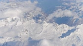 ridgeline : The Alps snowy mountains and clouds, aeial view. 4K clip Stock Footage