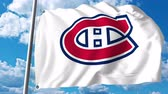 play : Waving flag with Montreal Canadiens NHL hockey team logo. 4K editorial clip