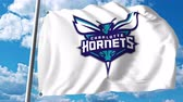 hornets : Waving flag with Charlotte Hornets professional team logo. 4K editorial clip