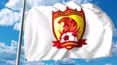 waving : Waving flag with Guangzhou Evergrande Taobao FC football club logo. 4K editorial clip