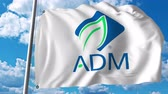 daniels : Waving flag with Archer Daniels Midland logo. 4K editorial animation