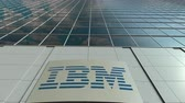 ibm : Signage board with IBM logo. Modern office building facade time lapse. Editorial 3D rendering