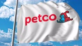 business : Waving flag with Petco logo. Stock Footage