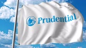 financial : Waving flag with Prudential Financial logo. Stock Footage