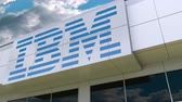 ibm : IBM logo on the modern building facade. Editorial 3D rendering Stock Footage