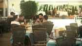 metáfora : PULA, CROATIA - AUGUST 4, 2017. Young male friends eat out in a street cafe