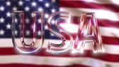 resim yazı : Rotating glass USA caption against waving American flag. Loopable motion background or intro animation