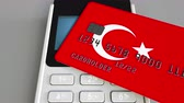 cardholder : Payment or POS terminal with credit card featuring flag of Turkey. Turkish retail commerce or banking system conceptual animation