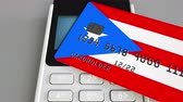 cardholder : Payment or POS terminal with credit card featuring flag of Puerto Rico. Retail commerce or banking system conceptual animation