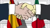 desenhado : Businessmen or politicians shaking hands against flags of Spain and Mexico. Meeting or cooperation related cartoon animation Stock Footage