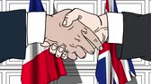 spojené království : Businessmen or politicians shaking hands against flags of France and Great Britain. Meeting or cooperation related cartoon animation