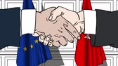 diplomat : Businessmen or politicians shaking hands against flags of EU and Turkey. Meeting or cooperation related cartoon animation Stock Footage