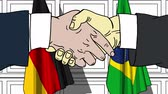 desenhada à mão : Businessmen or politicians shaking hands against flags of Germany and Brazil. Meeting or cooperation related cartoon animation Vídeos