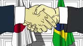 brasileiro : Businessmen or politicians shaking hands against flags of Japan and Brazil. Meeting or cooperation related cartoon animation Vídeos