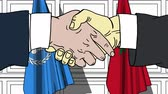 марокканский : Businessmen or politicians shake hands against flags of United Nations and Morocco. Official meeting or cooperation related editorial animation