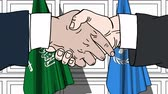 diplomat : Businessmen or politicians shake hands against flags of Saudi Arabia and United Nations. Official meeting or cooperation related editorial animation