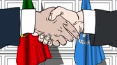 diplomat : Businessmen or politicians shake hands against flags of Portugal and United Nations. Official meeting or cooperation related editorial animation Stock Footage