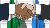 diplomat : Businessmen or politicians shake hands against flags of Nigeria and United Nations. Official meeting or cooperation related editorial animation