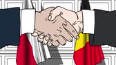 belga : Businessmen or politicians shake hands against flags of Poland and Belgium. Official meeting or cooperation related cartoon animation