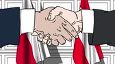 austrian : Businessmen or politicians shake hands against flags of Poland and Austria. Official meeting or cooperation related cartoon animation