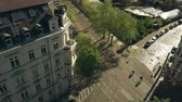 almanca : Aerial view of people riding bikes along sunny street in Leipzig, Germany Stok Video