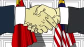 diplomat : Businessmen or politicians shake hands against flags of China and Malaysia. Official meeting or cooperation related cartoon animation Stock Footage