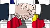 desenhado : Businessmen or politicians shake hands against flags of France and Belgium. Official meeting or cooperation related cartoon animation Stock Footage