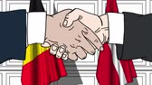 belga : Businessmen or politicians shake hands against flags of Belgium and Denmark. Official meeting or cooperation related cartoon animation Vídeos