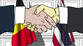 diplomat : Businessmen or politicians shake hands against flags of Belgium and Thailand. Official meeting or cooperation related cartoon animation