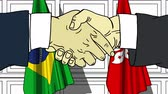 cartoon : Businessmen or politicians shake hands against flags of Brazil and Hong Kong. Official meeting or cooperation related cartoon animation