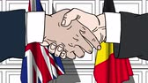 diplomat : Businessmen or politicians shake hands against flags of Britain and Belgium. Official meeting or cooperation related cartoon animation