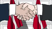 Дания : Businessmen or politicians shake hands against flags of Denmark. Official meeting or cooperation related cartoon animation Стоковые видеозаписи