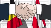 diplomat : Businessmen or politicians shake hands against flags of Belgium and Austria. Official meeting or cooperation related cartoon animation