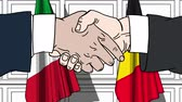 belga : Businessmen or politicians shake hands against flags of Italy and Belgium. Official meeting or cooperation related cartoon animation