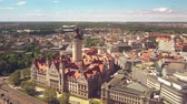 административное здание : LEIPZIG, GERMANY - MAY 1, 2018. Aerial view of the Neues Rathaus or New Town Hall within cityscape