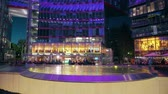 almanca : BERLIN, GERMANY - APRIL 30, 2018. Illuminated Sony Center interior in the evening